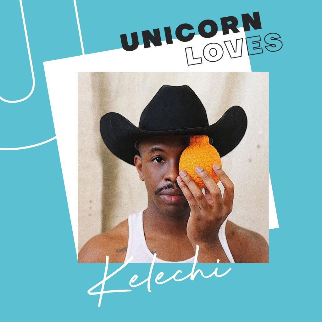 With a blue UNICORN LOVES border, Kelechi is wearing a black cowboy hat and white vest, staring directly at the camera and holding an orange directly over one of their eyes and half of their moustache