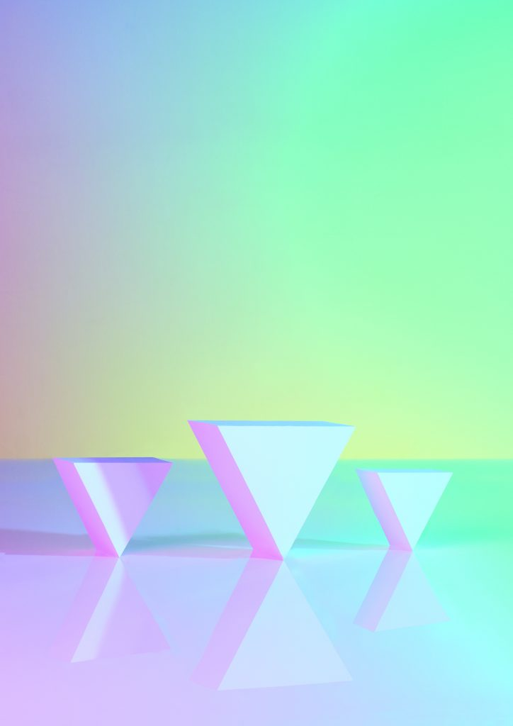 Pastel purple, yellow, turquoise and blue gradient with three upside down triangles positioned at an angle in the middle. The middle triangle is larger and the left and right are smaller.