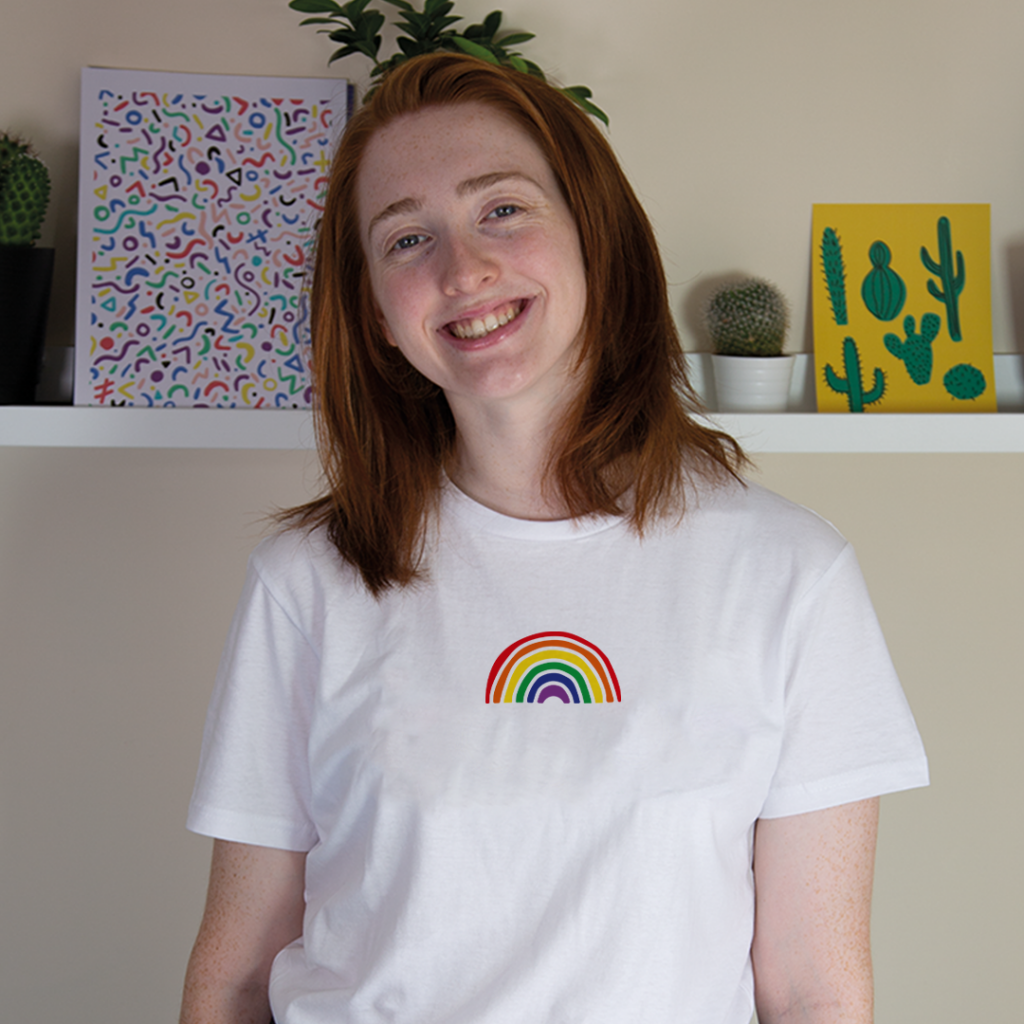 A Splodge white t-shirt with a rainbow on it.