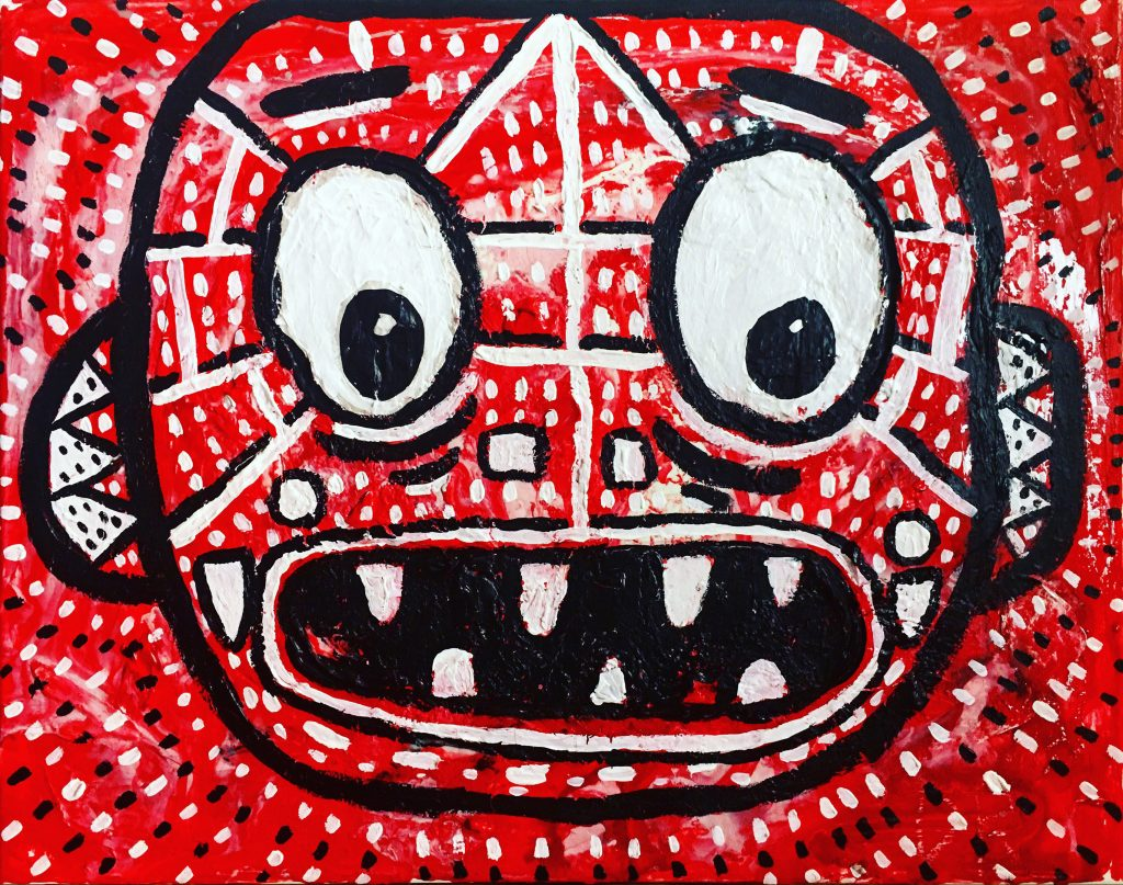 Red, white and black painted piece. Patterned around the entire rectangle with rectangle dots. The centre is a line painting of a face. The expression is wide eyed and shocked. We see four upper teeth and 3 lower teeth in the open mouth. The face is abstract with different shaped ears with white triangle patterns in. There are white and black lines all over the face and two angles straight lines for eyebrows.