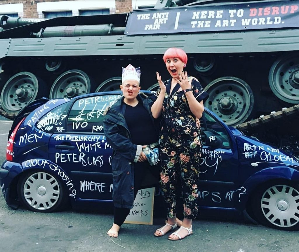 """Co founders of Nasty Women North East and the """"(small but) FIERCE Magazine"""" artist Lady Kitt (as King Kitt) and curator Michaeal Wetherell, The Anti Art Fair, London 2018"""