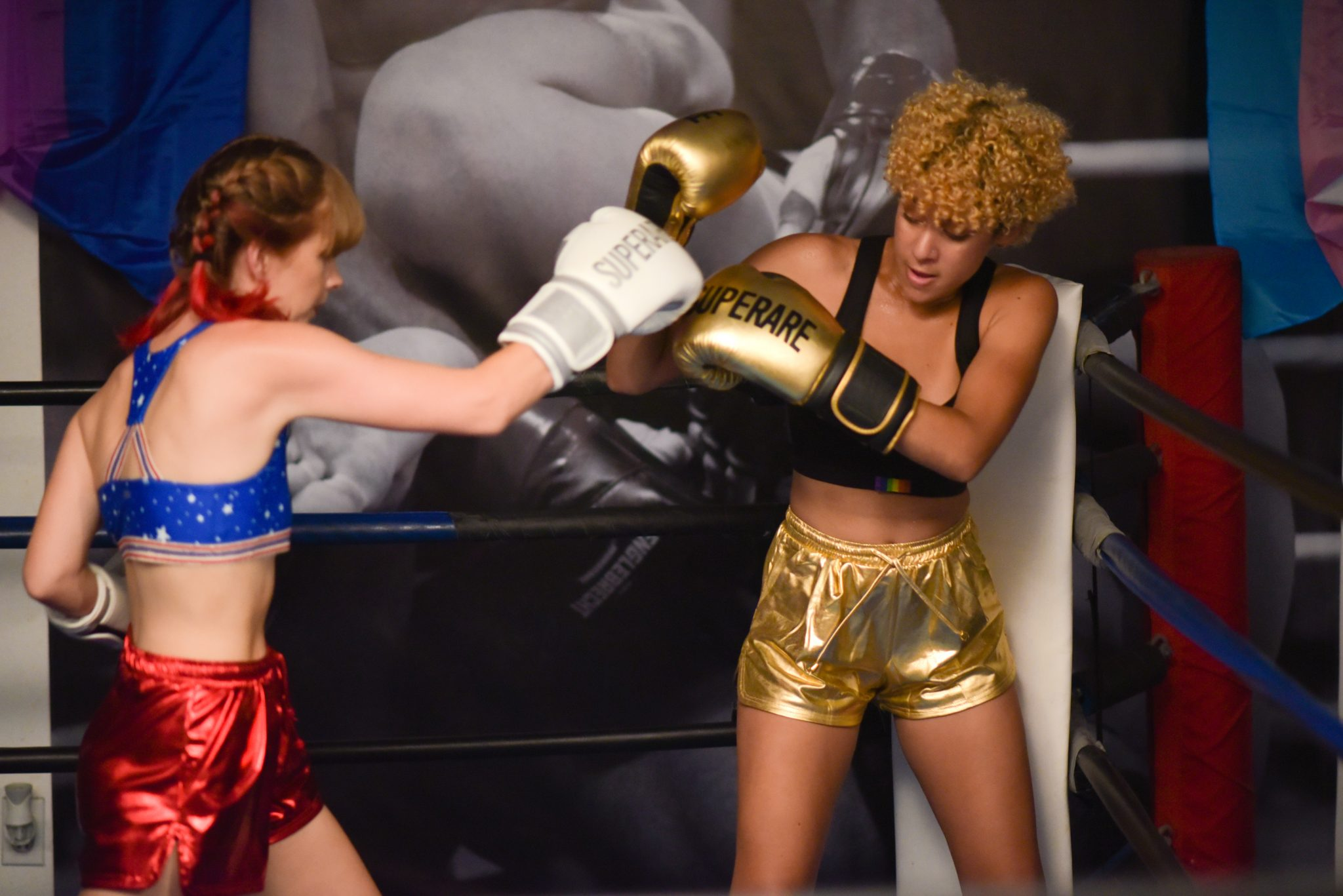 In a still from the video, Lucy and Moony Maroon spar in a boxing ring.