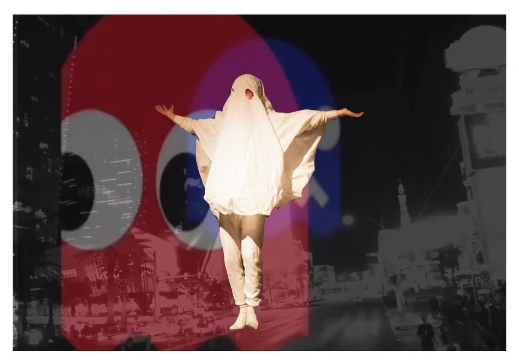 TS IDIOT collage, Tom is dressed as a ghost, in a sheet with two holes cut for eyes. The background is a faded inverted colour cityscape, a large Pac Man ghost looms, the red ghost - Blinky.