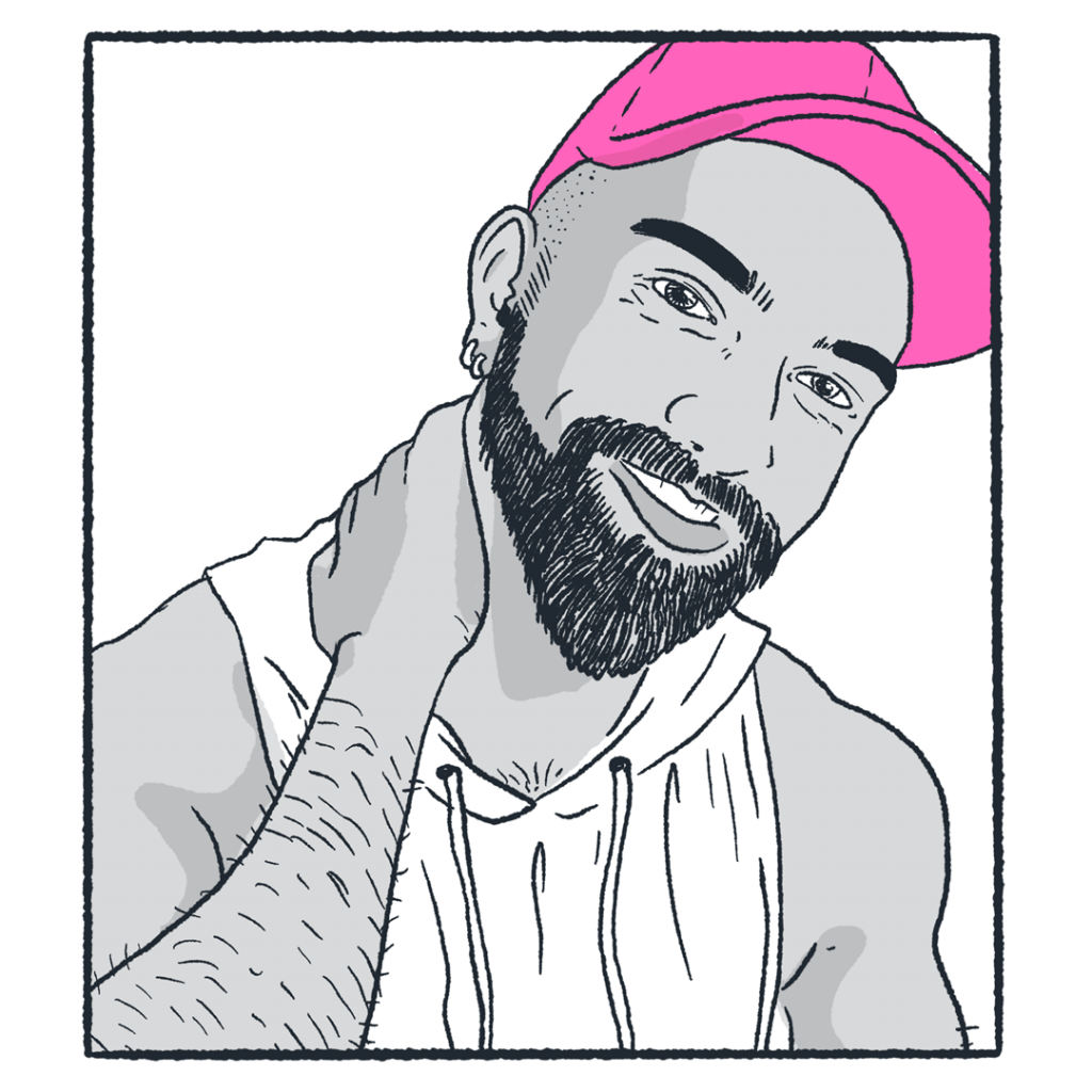 Mukesh is leaning his head cutely to one side, smiling at the camera and resting his hand on his neck, just below his neatly trimmed dark beard. He is wearing a bright pink cap.