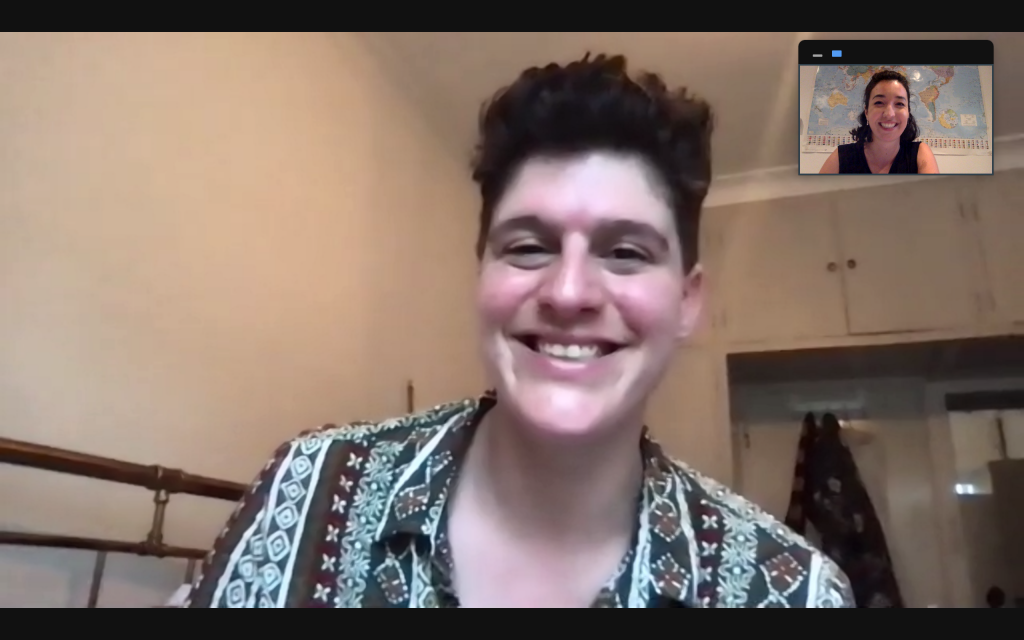 We see a screenshot of an online video call between Rain Dove and Bella Cox (article author). Rain Dove is smiling and wearing a paisley pattern shirt. Bella is smiling back at the camera in a black top.