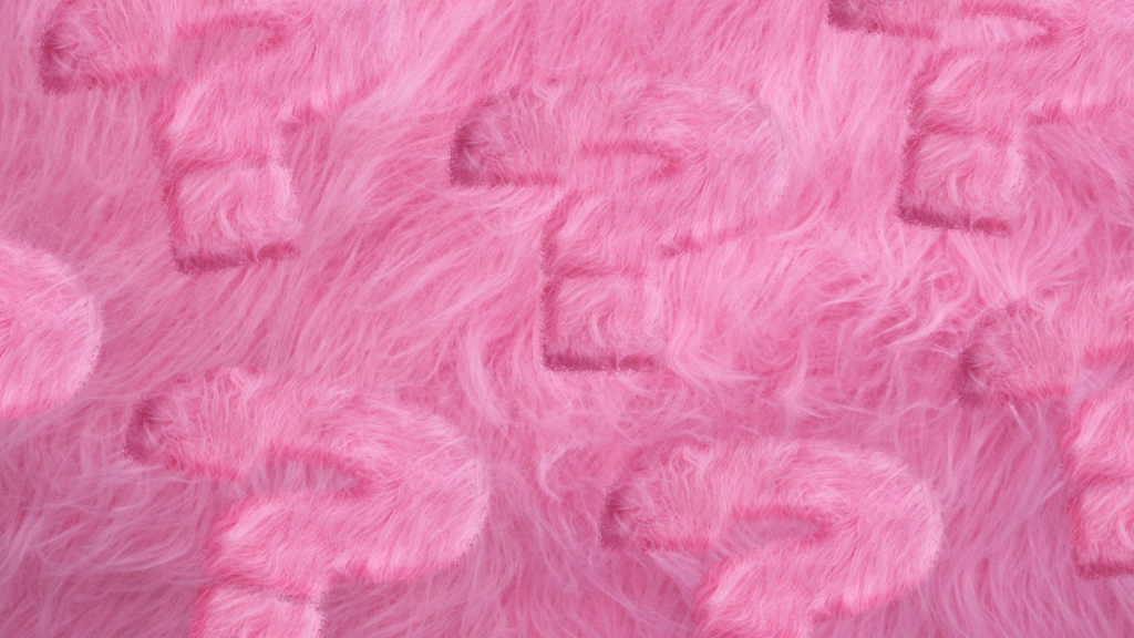 A pink fluffy background with pink fluffey textured question marks photoshopped into the background.
