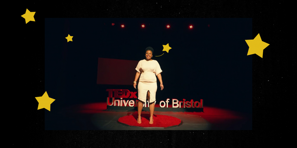 Sanisha - a proud, smiling Black woman with her natural hair tied up in a bun - stands on the red and black TedX Bristol stage. The photo is surrounded by cute cartoon stars in egg-yolk yellow.