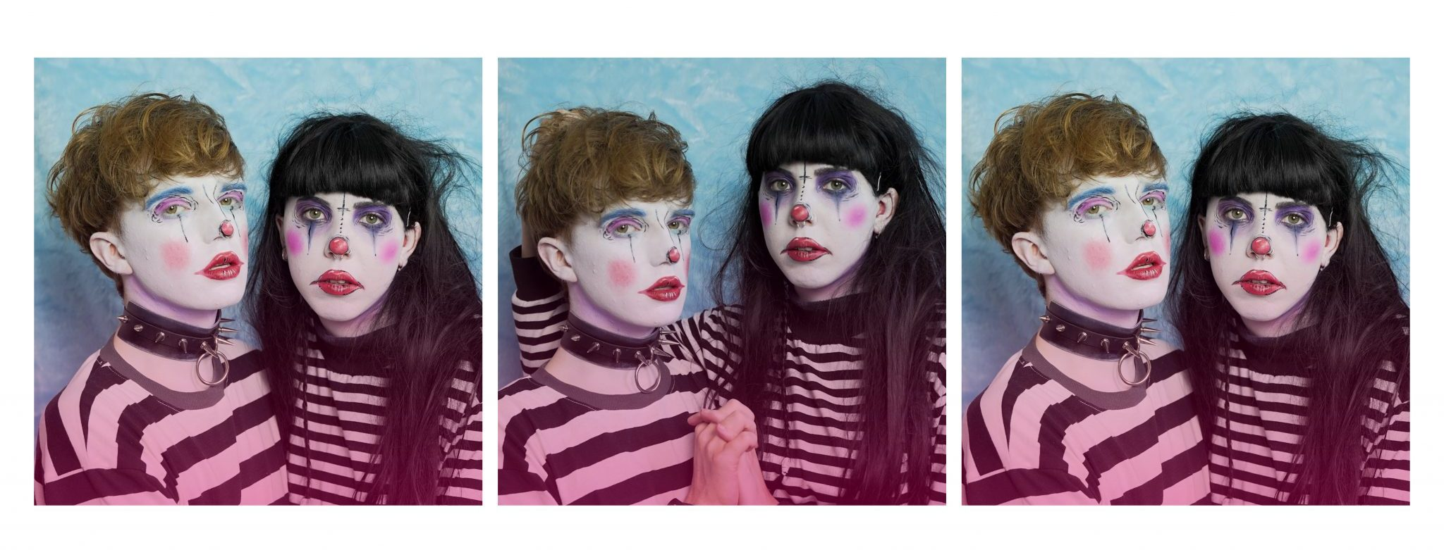 A tryptich of images, each slightly different from each other in pose - featuring Alex Cubb and Remi May. Alex is to the left and is wearing a thick black and white striped t-shirt with faux leather spiked wrist and neck cuffs. He has clown style makeup, white face, red cheeks, lips and nose. He has light brown short hair. Remi is to the right, she is wearing a long sleeved thin striped black and white t-shirt. She has similar makeup to Alex with darker eye makeup. Her hair is long and dark with a short full fringe. They are facing the camera.
